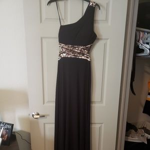 Black ball gown with open back and beading